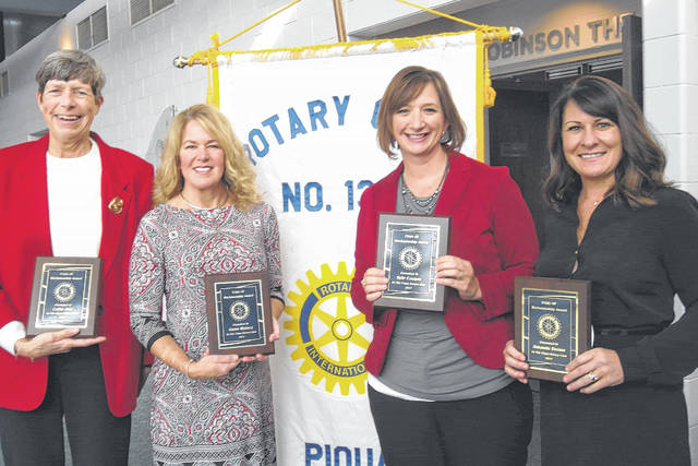 Provided photo The Piqua Rotary Club recently presented Pride of Workmanship awards to four local women. Award recipients, left to right, are Cathy Oda, Dawn Widney, Kyle Cooper and Amanda Brown.