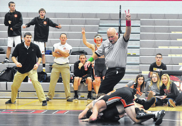 Mike Ullery | Daily Call A variety of onlooker reactions accompany referee David Friend's awarding reversal points to a Versailles wrestler during a dual match between Covington and Versailles at Covington High School on Tuesday. For more photos and match results, see page 11.