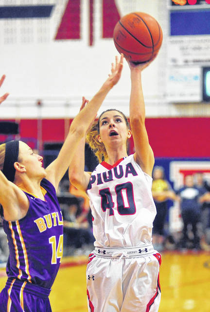 Mike Ullery | Daily Call Piqua's Lily Stewart shoots against Abbie Schoenherr Wednesday night at Garbry Gymnasium.