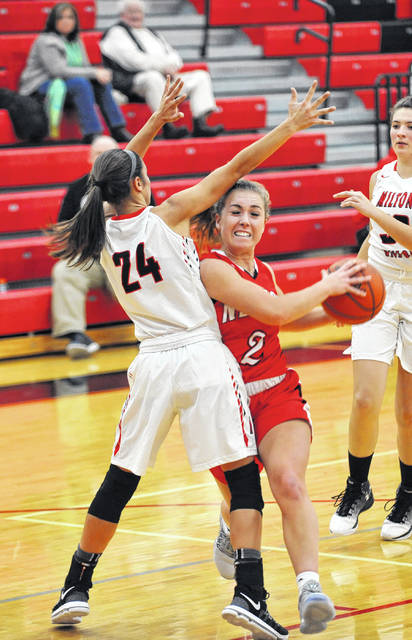 Josh Brown/Aim Media Photo Newton's Tatum McBride makes a move to the basket against Milton-Union Thursday.