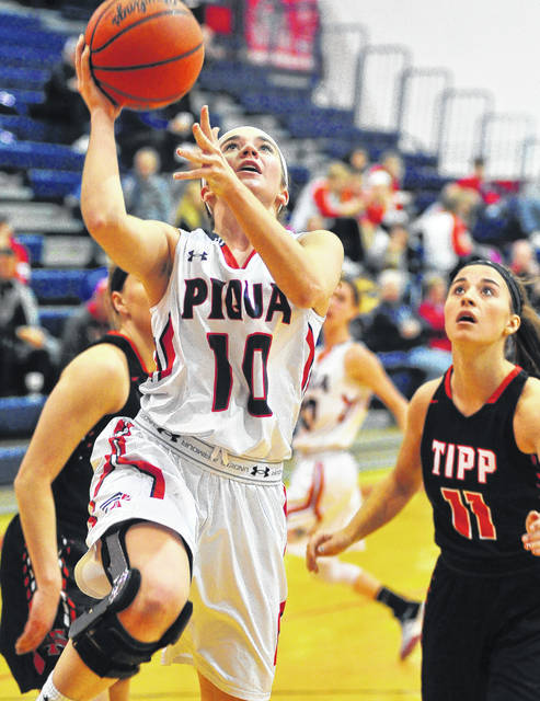 Mike Ullery | Daily Call Piqua's Kelsey Magoteauz shoots a layup against Tippecanoe Saturday at Garbry Gymnasium.