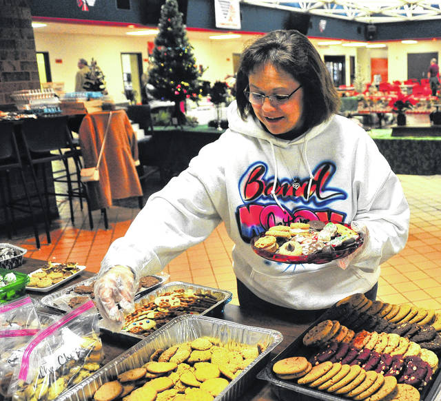 Mike Ullery | Daily Call Chelsea Applegate packages cookies on Saturday in preparation for last Sunday's annual Cookie Walk at Piqua High School to benefit the Piqua Show Choir.