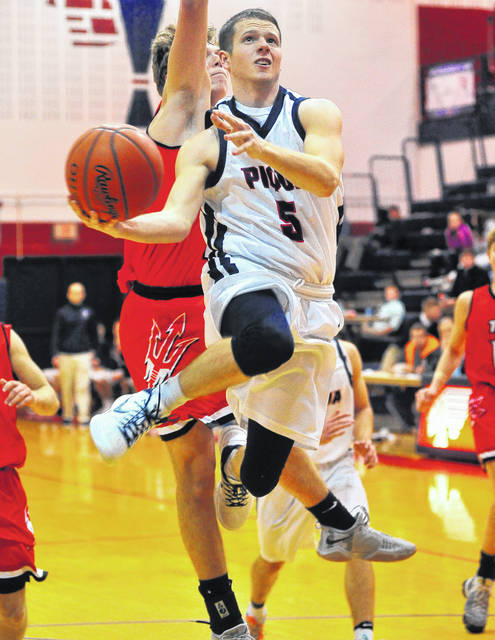 Piqua's Cory Cottrell goes up for two points Tuesday night against Tippecanoe.