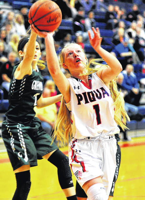 Mike Ullery | Daily Call Piqua's Lauren Williams goes up for two points against Greenville Saturday night.