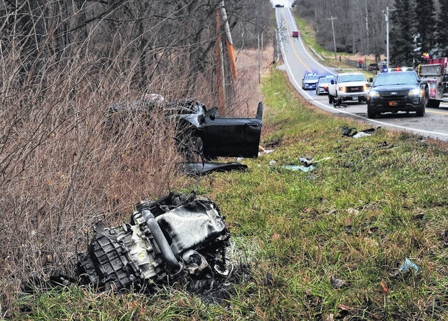 Mike Ullery | Daily Call The engine from a crashed vehicle rests some 15 yards in front of the wreckage in the 4000 block of St. Rt. 201 on Monday afternoon.