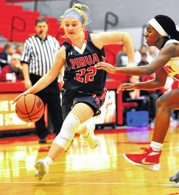 Mike Ullery | Daily Call Kelsey Bachman, 22, races down the floor for the Indians.