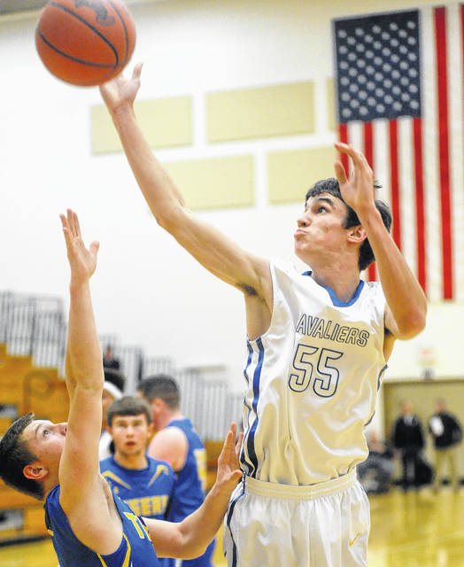 Mike Ullery | Daily Call Lehman Catholic's Conor O'Leary puts up a shot over the Waynesfield-Goshen defense.
