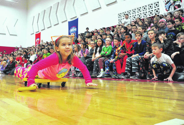 "Mike Ullery | Daily Call Kaitlyn Szachta, a fourth-grader at Piqua Central Intermediate School, participates in ""Reindeer Games"" events at the school on Friday."