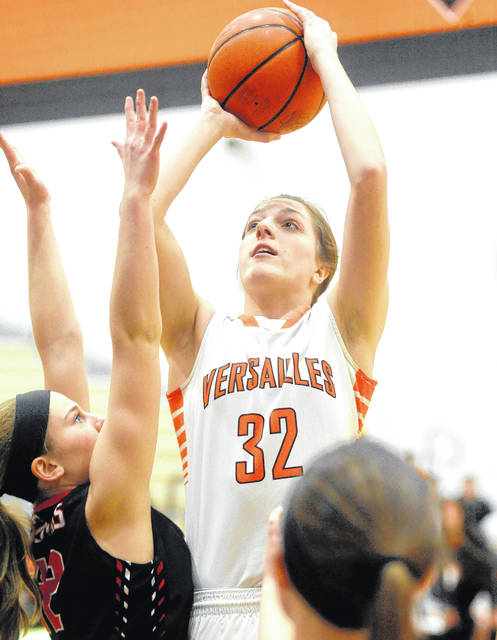 Mike Ullery | Daily Call Versailles Danielle Winner, 32, scores over the Fort Loramie defense