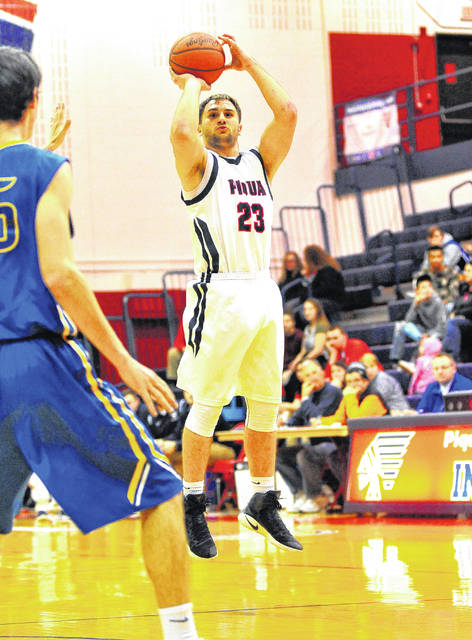 Mike Ullery | Daily Call Piqua's Ben Schmiesing fires from three-point range against Lehman Catholic Thursday night.