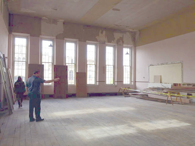 Steve Smith, propietor of The Caroline and owner of the Dye Building, provides a preview of the south ballroom in the Dye Building last month. Troy Planning Commission tabled the proposed Downtown Riverfront Overlay district zoning initiative.