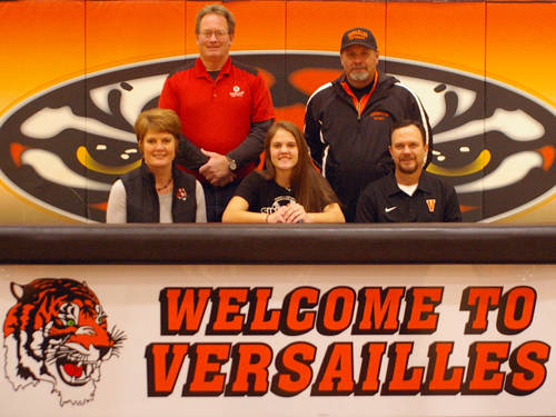 Versailles' Hailey McEldowney signed her letter of intent on Friday to play softball at Sinclair Community College. Pictured are (front row, l-r) mother Julie McEldowney, Hailey McEldowney, father Scott McEldowney, (back row, l-r) Sinclair coach Steve Beachler and Versailles softball coach Chris Floyd.