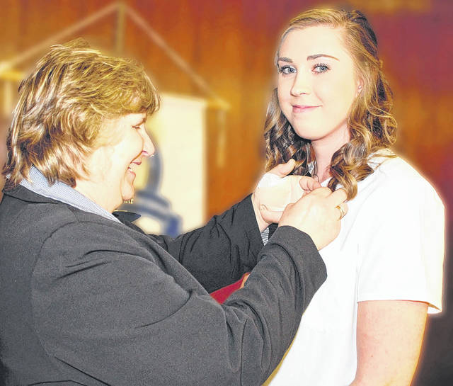 Provided photo Holly Shaffer of Troy, a graduate of the Practical Nursing program at the Upper Valley Career Center's Adult Division, receives recognition for superior attendance and highest academic Honors during a ceremony on Dec. 21.