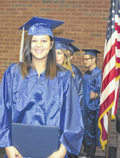 Provided photo Aspire program graduate Danielle Jones, of Troy, exits the stage after receiving her diploma at Upper Valley Career Center on Nov. 30.