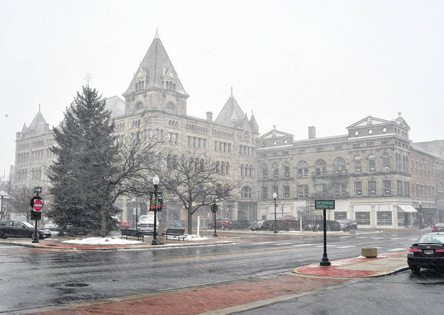 Mike Ullery | Daily Call A snow squall moves through downtown Piqua on Tuesday. Intermittent heavy snow and wind followed by bright sunshine, then back again … typical Ohio weather … met those who ventured outdoors on Tuesday. The only constant was the cold temperature.