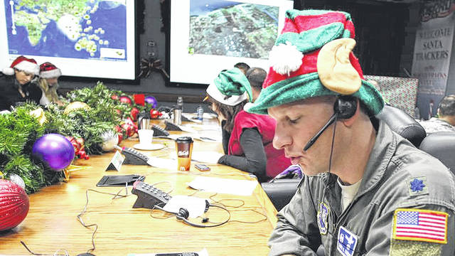 Provided photo Volunteer elves keep tabs on St. Nick through NORAD Tracks Santa, which allows kids from 1 to 92 to follow the jolly old elf around the world online, via mobile apps and on social media as he delivers presents on Christmas Eve.