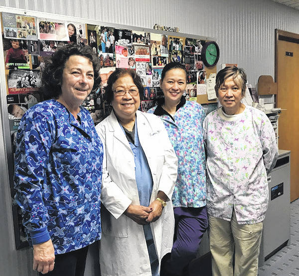 Melody Vallieu | AIM Media Midwest Dr. Victoria Ocampo, left, stands with her office employees, Kathy Greene, Vicky Ocampo and Virgie Ocampo.