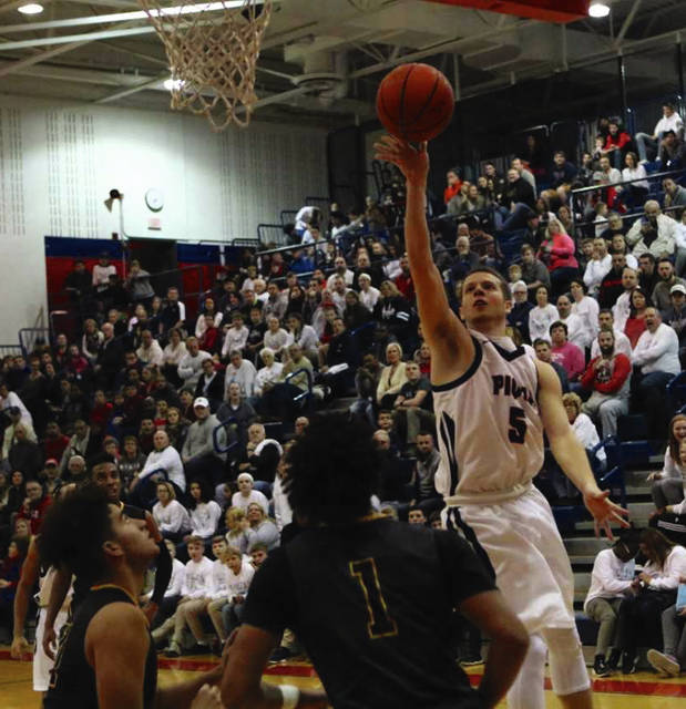 Tom Lillicrap/For The Call Piqua's Cory Cottrell goes up for two points Friday night.
