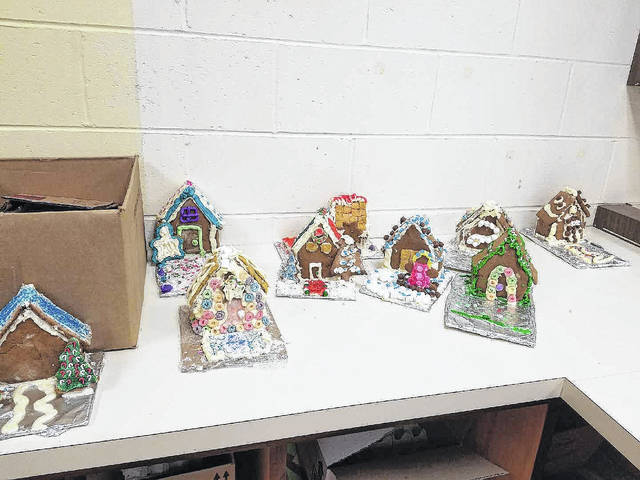 Provided photo Family Consumer Science teacher Deborah Rezabek recently encouraged her students to get in the holiday spirit with the creation of gingerbread houses.
