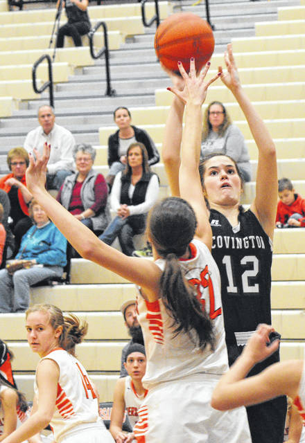 Rob Kiser/Call Photo Covington's Lillian Hamilton shoots over Danielle Winner Saturday.