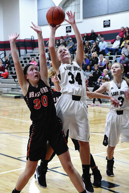 Ben Robinson/GoBuccs.com Covington's Tori Lyle shoots against Bradford's Brooke Fair Monday night.