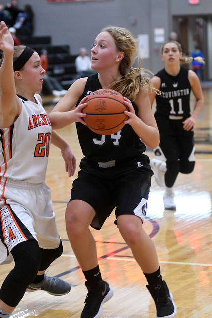 Ben Robinson/GoBuccs.com Covington's Tori Lyle eyes two points against Arcanum Thursday.