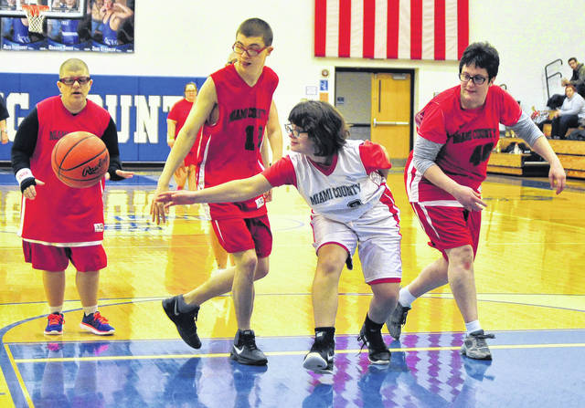 Mike Ullery | Daily Call The Riverside Special Olympics basketball team was in high gear during an exhibition game at Miami East High School on Thursday. Pictured are, l-r, Jeri Jo Thomas, Topher Eller, Heidi Denlinger, and Paula Baker. The team played during half-time of the Miami East vs. Newton girls game.