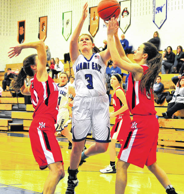 Mike Ullery | Daily Call Bailey Miller fights off a double-team to score for Miami East.