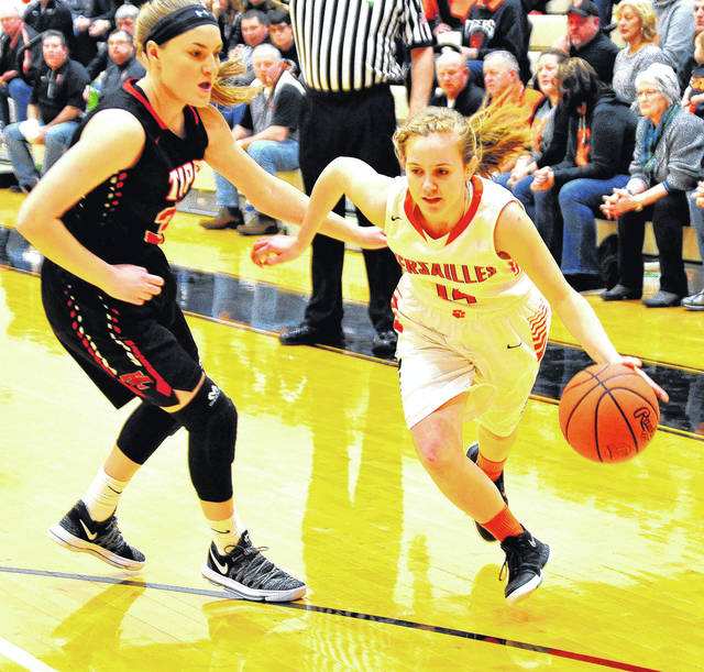 Mike Ullery | Daily Call Caitlin McEldowney, 14, drives through the Red Devils defense