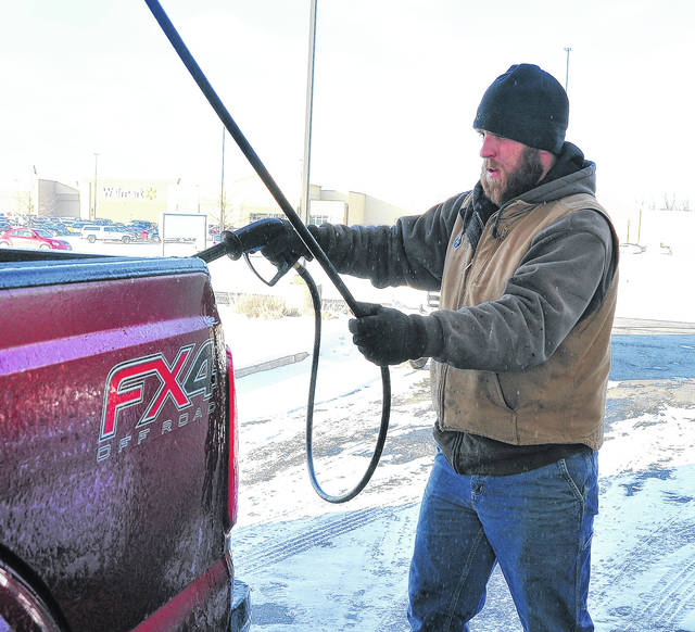 Mike Ullery | Daily Call Zach Rittenhouse of Houston hits the Super Wash in Piqua on Saturday to get some of the road grime and salt off of his pickup truck. While temperatures still hovered just above zero, the sunshine encouraged many to venture out and begin cleaning up from our recent arctic weather pattern.