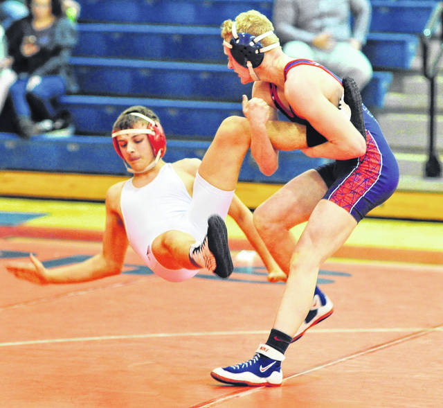 Mike Ullery | Daily Call Piqua's Sam Herndon takes his man to the mat.
