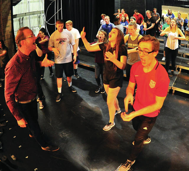 Mike Ullery | Daily Call Piqua High School vocal music director Tom Westfall, left, leads The Company in a rehearsal on Thursday. The group was fine-tuning their competition show for today's Piqua Show Choir Invitational event at PHS.