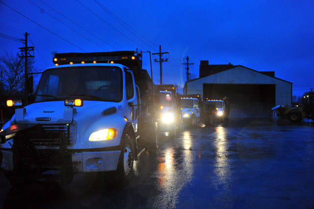 The City of Piqua street crews lbegin loading salt in the pre-dawn hours on Friday in anticipation of freezing rain falling over the area later this morning.