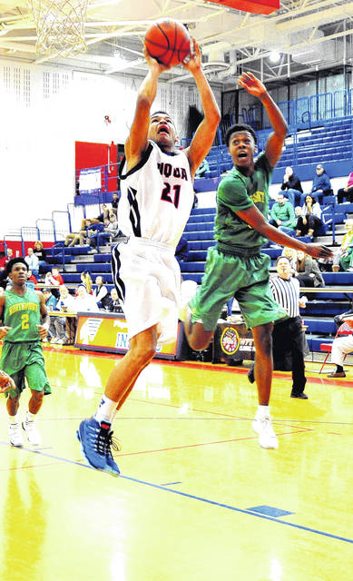 Mike Ullery | Daily Call Piqua's Qurri Tucker goes up for two of his game-high 30 points.