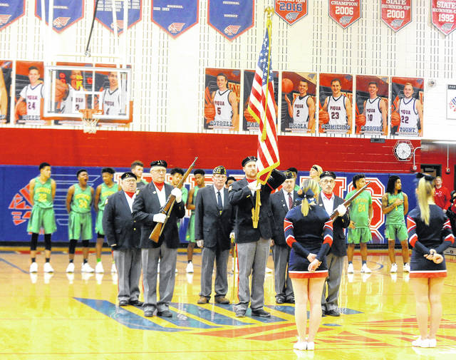 Mike Ullery | Daily Call An Honor Guard from Piqua American Legion Post 184 presents the Colors on Veterans Appreciation Night at Garbry Gym on Friday. The Ohio High School Athletic Association member schools held event honoring our nation's veterans at basketball game across the state over the weekend.