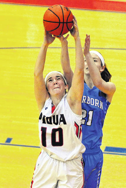 Mike Ullery | Daily Call Piqua's Kelsey Magoteaux (10) battles for a rebound with Fairborn's Ashley Dagnan Saturday.
