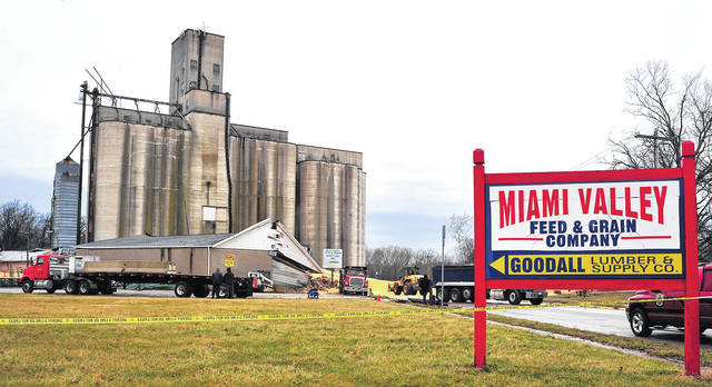 Dozens of workers begin the task of moving corn, estimated to be in the hundreds of thousands of bushels, from St. Rt. 571 at the west end of The City of New Carlisle on January 22, 2018 followng the early morning collapse of a grain bin.