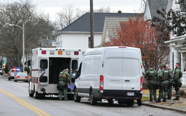 Mike Ullery | Daily Call TRT members from Piqua work at the scene of a standoff in the 1000 block of Park Avenue in Piqua on Monday morning.