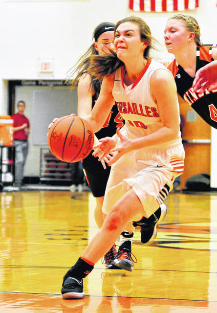 Mike Ullery | Daily Call Versailles' Kami McEldowney, has her eye on the basket Thursday against Minster.