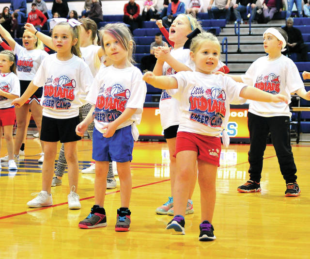 Mike Ullery | Daily Call Little Indian Cheer Camp participants got to cheer with the Piqua High School cheerleaders during halftime of Saturday's boys basketball game at Garbry Gym. Pictured front, l-r, Bristol Graham, 6; Julianna Jenkins, 5; and Madilyn Tackett, 4.
