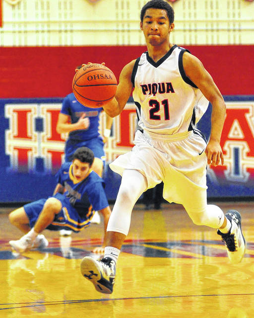 Mike Ullery/Call File Photo Qurri Tucker and the Piqua boys basketball team will have a busy weekend.
