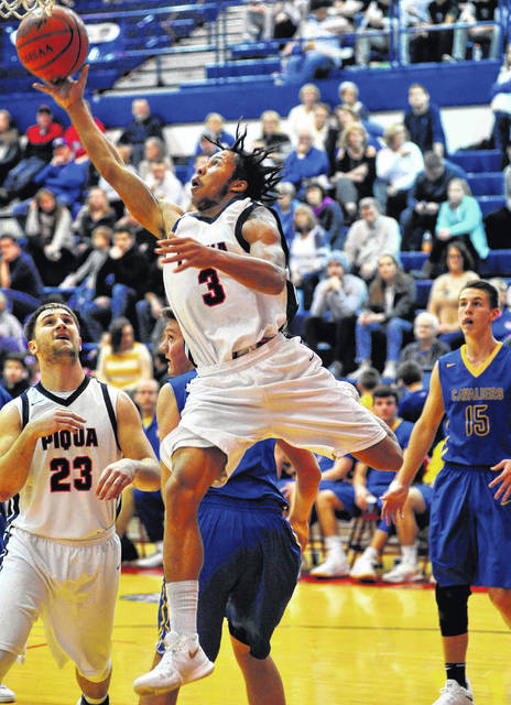 Mike Ullery/ Call File Photo Piqua's Devon Brown goes up for two points earlier this season.
