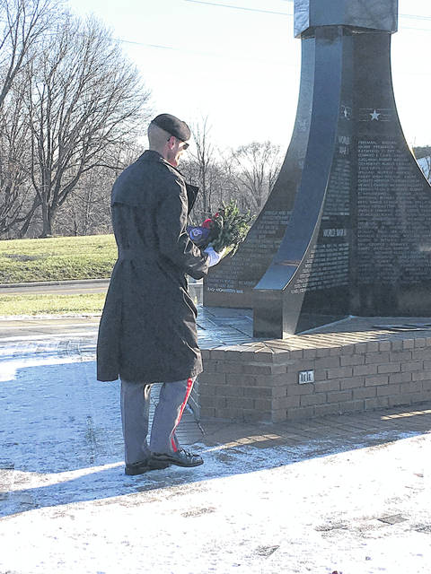 Provided photo A member of the Veterans Elite Tribute Squad places a wreath at the Veterans Memorial in Forest Hill Cemetery last month.