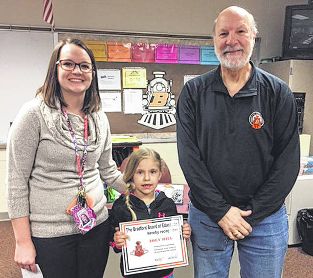 Bradford Schools Student of the Month Zoey Hill (center) is pictured with her teacher Jana Barga (left) and School Board Member Scott Besecker.