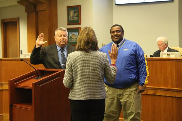 Courtesy of Brittany Van Horn | City of Piqua Incoming commissioners David Short (left) and Kris Lee (right) are sworn in by City Attorney Stacy Wall (middle) during the Piqua City Commission meeting Tuesday evening.