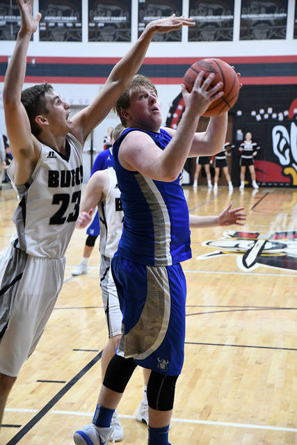 Ben Robinson/GoBuccs.com Miami East's Austin Kearns looks to score as Covington's Braden Miller defends Tuesday night.