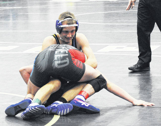 Rob Kiser/Call Photo Andrew Barhorst of Lehman Catholic fights off Nathan Dewey of Northwestern in a 152-pound match.