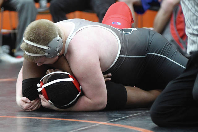 Ben Robinson/GoBuccs.com Covington's Bryce Keiser goes for a pin in a 285-pound match.