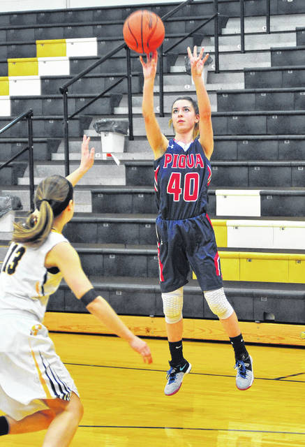 Mike Ullery | Daily Call Piqua's Lily Stewart puts up three of her game-high 29 points against Sidney on Saturday.