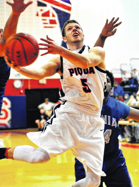 Mike Ullery | Daily Call Piqua's Cory Cotrell gets off a shot in the lane against Xenia.